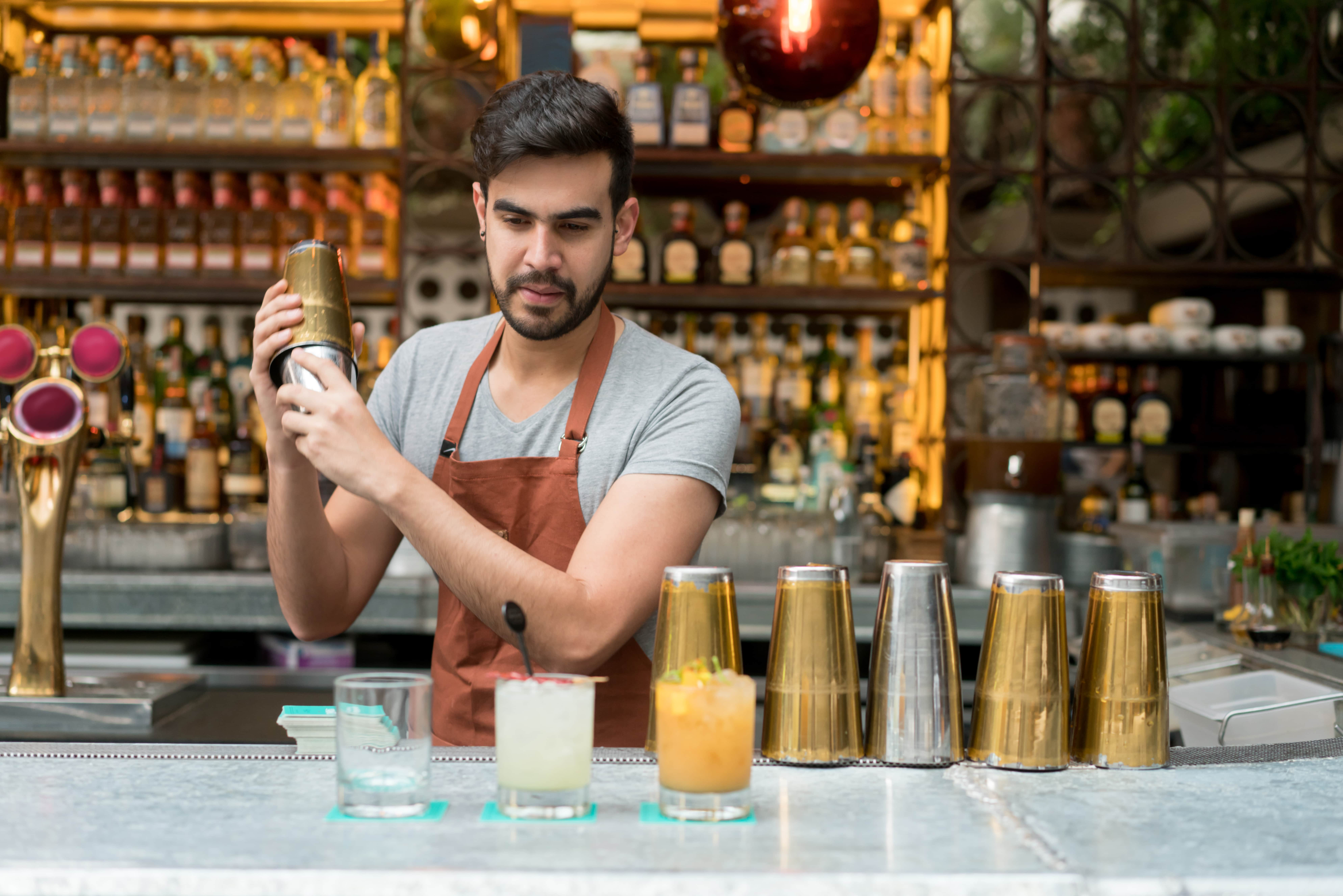 Barman with gold shaker-min